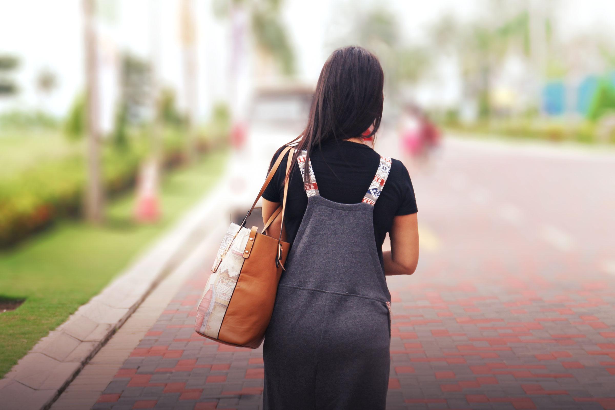 stockvault-woman-walking-away218845